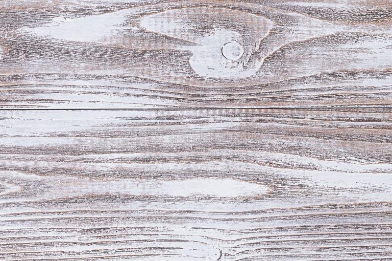 Superficie de madera pintada con la pintura acrílica blanca foto de archivo libre de regalías