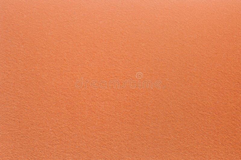 Superficie del feltro nel colore arancio Priorità bassa e struttura astratte immagini stock