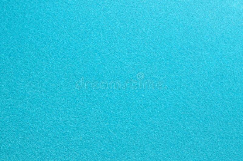 Superficie del fieltro en color azul claro abstraiga el fondo imagenes de archivo