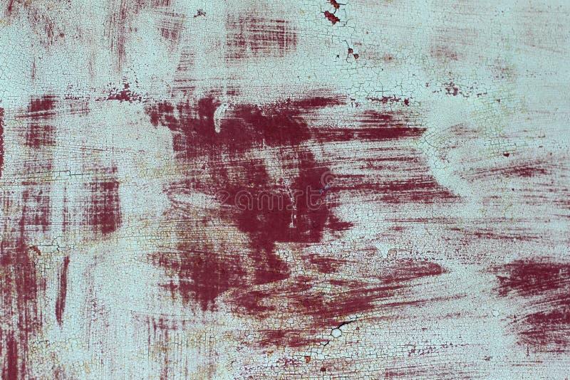 Superficie del hierro oxidado con los remanente del viejo fondo multicolor de la textura de la pintura Moho, corrosión en el meta foto de archivo libre de regalías