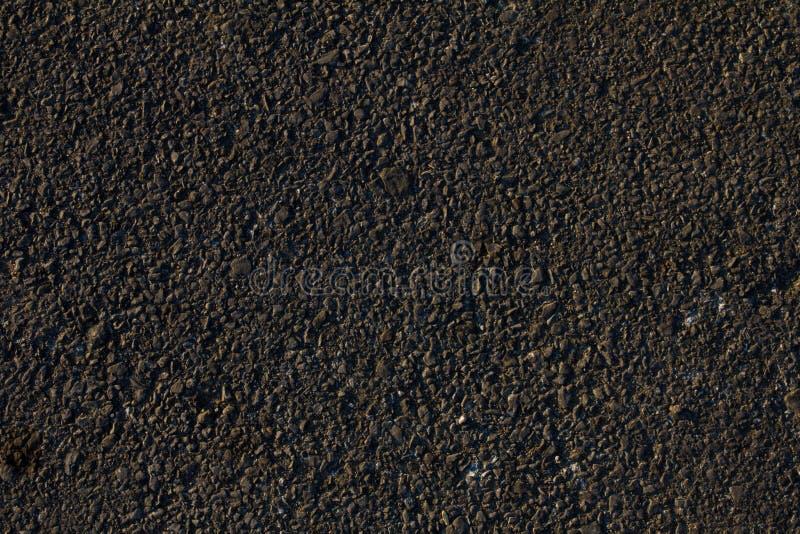 Superficie dell'asfalto del nero scuro, fondo immagine stock