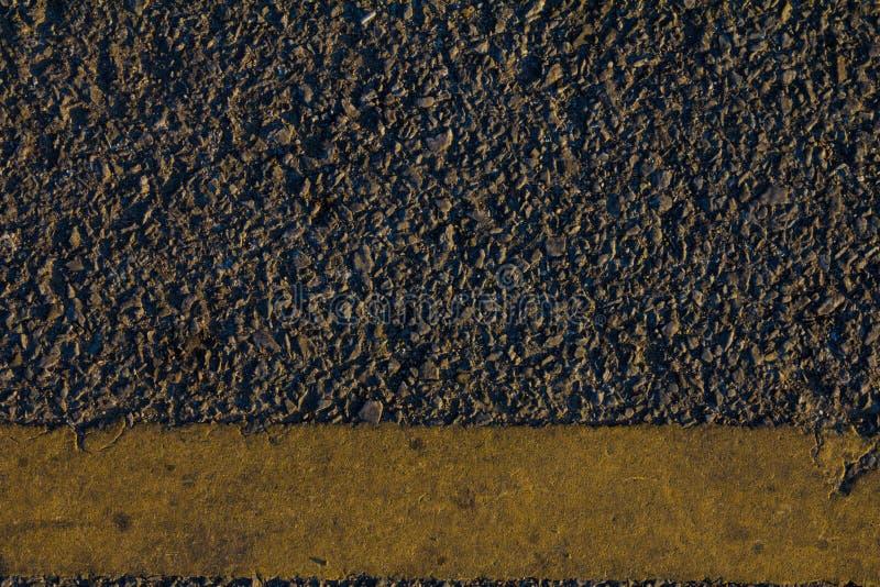 Superficie dell'asfalto del nero scuro, fondo fotografie stock