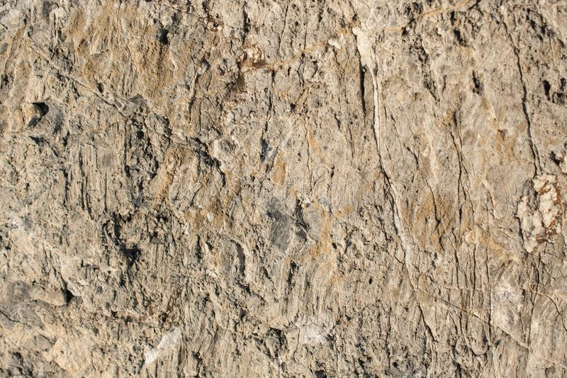 Superficie della pietra o della roccia come struttura del fondo fotografia stock libera da diritti