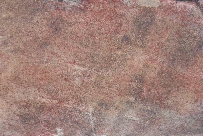 Superficie della pietra rosso scuro naturale come fondo immagini stock