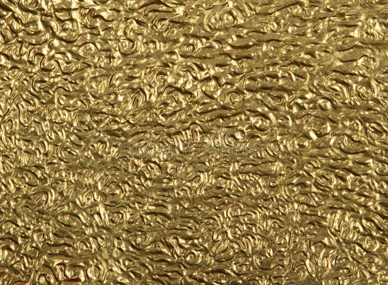 Superficie della stagnola di oro del primo piano fotografia stock libera da diritti