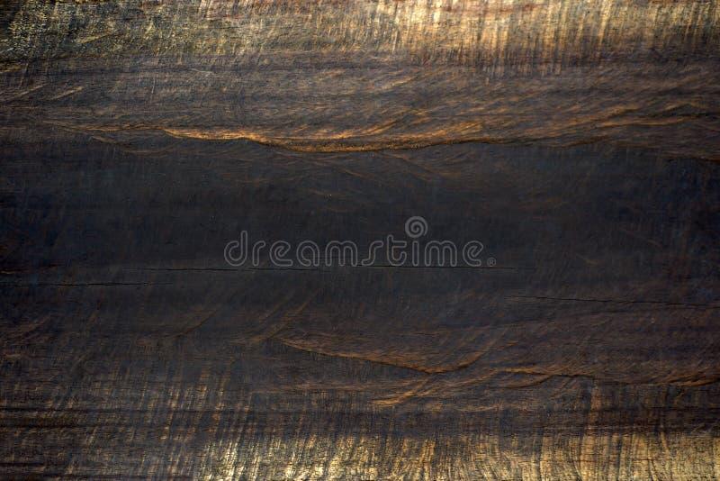 Superficie di legno scura del fondo di struttura con il vecchio modello naturale Primo piano del fondo nero di struttura di legno fotografia stock