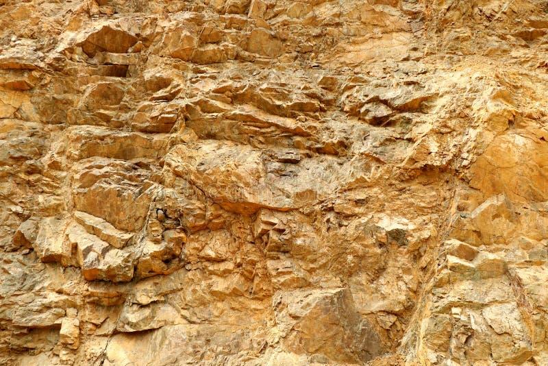 Superficie gialla della roccia fotografia stock