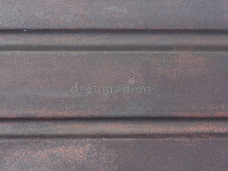 Superficie metálica de la textura gris oscuro del fondo foto de archivo libre de regalías