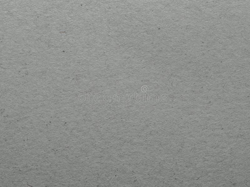 Superficie riciclata delle casse di carta o del fondo grigio dello strato di Kraft fotografie stock libere da diritti