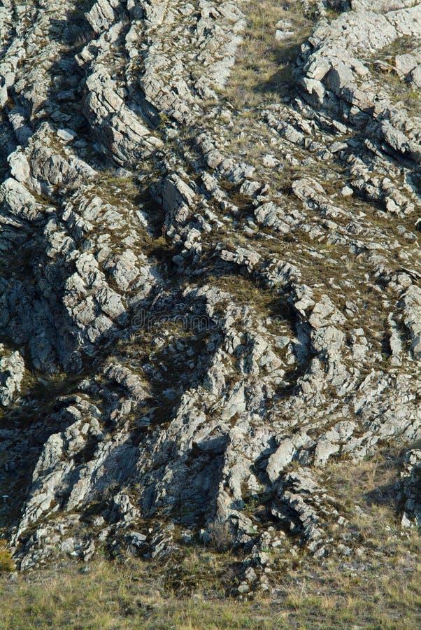 Superficie rocciosa grigia della montagna nelle montagne di Sayan fotografia stock libera da diritti