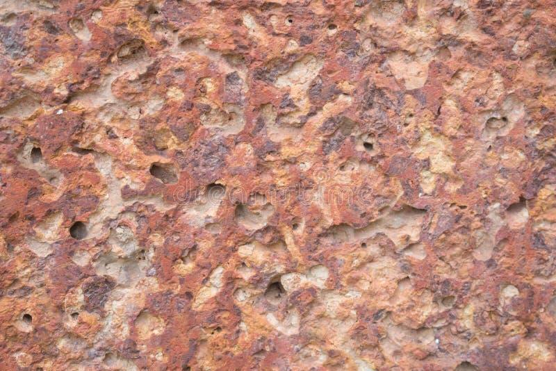 Superficie rossa della pietra della laterite, fondo di struttura fotografie stock libere da diritti