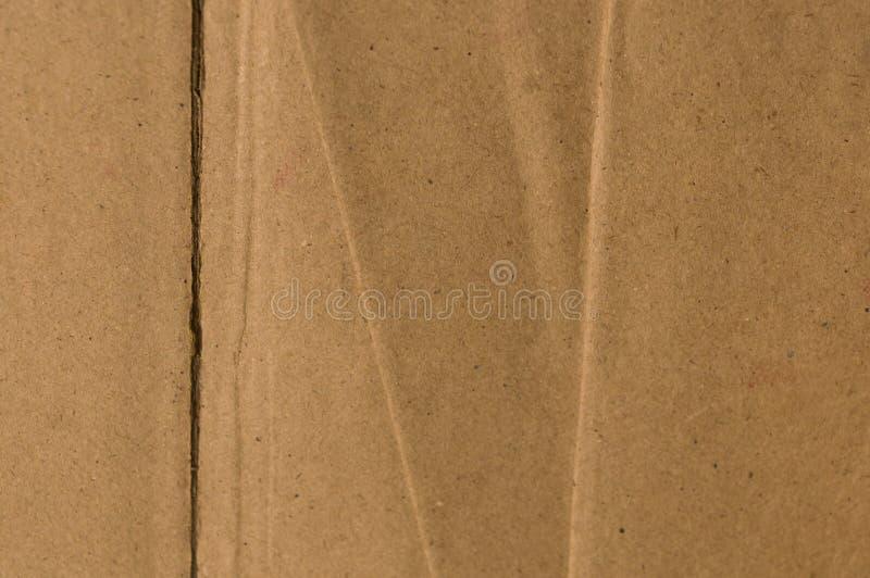 Superficie scatola d'annata di colore di marrone dello strato lacerato e del taglio di vecchia e del cartone di carta Fine astrat immagine stock