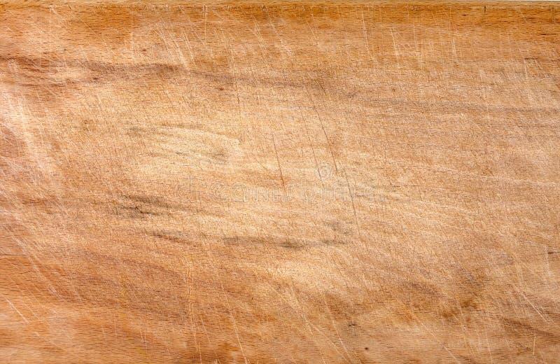 Superficie tagliente di legno graffiata usata, fondo di struttura fotografia stock libera da diritti