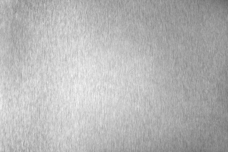 Superficie vacía brillante del metal plateado, fondo metálico brillante monocromático, cierre blanco y negro cepillado del contex fotos de archivo libres de regalías