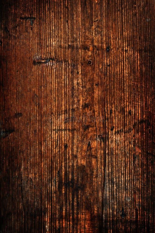 Superficiel par les agents obscurcissez le mur de bois de construction images libres de droits