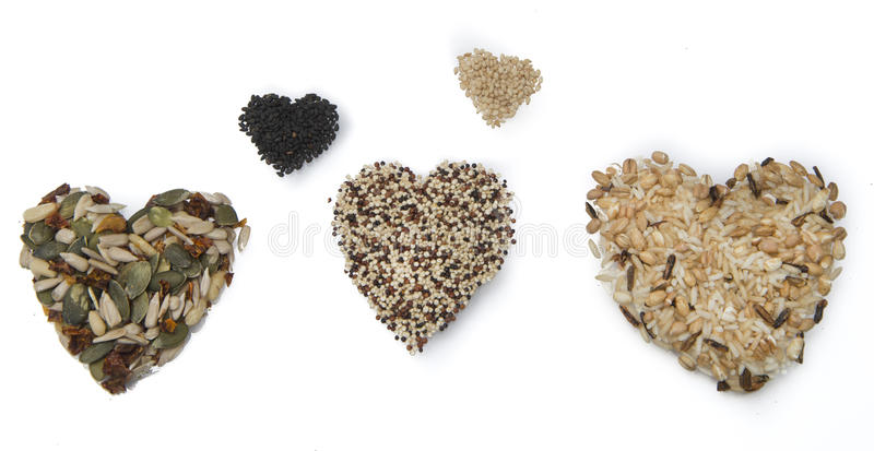 Superfood hearts. Black and white sesame, wild rice, quinoa and pumpkinseeds stock photos