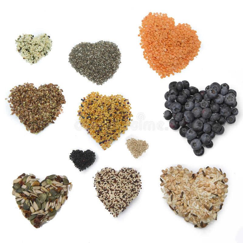 Superfood hearts. Grains and berries royalty free stock image