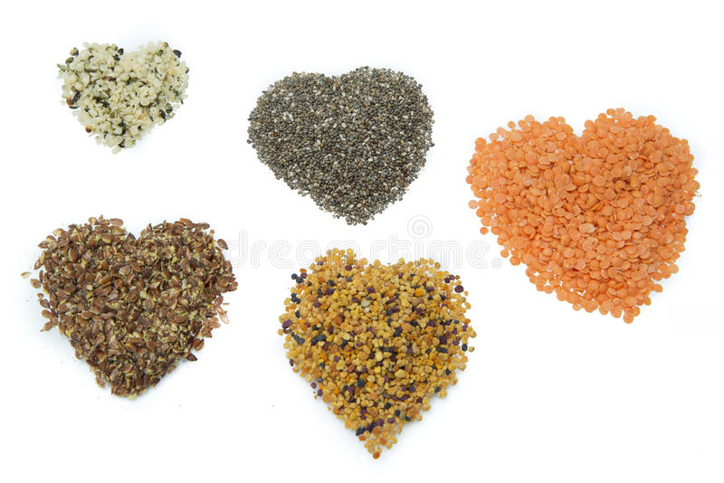 Superfood hearts. Hemp, chia, flax, bee pollen and linz stock photography
