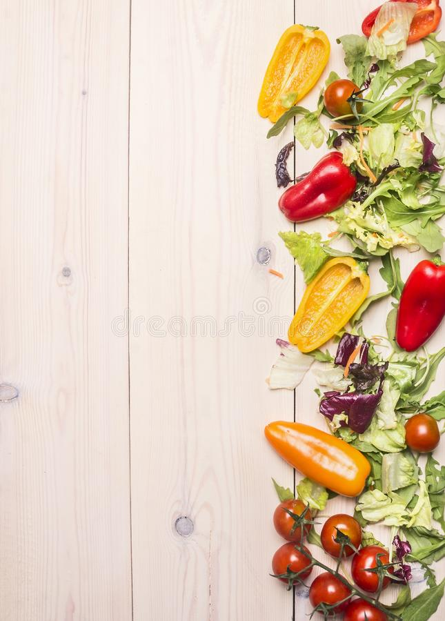 Superfoods and healthy lifestyle or detox diet food concept various vegetables and herbs on white wooden table, cherry tomatoes, royalty free stock photography