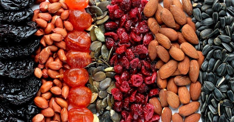 Superfoods tło: dokrętki migdał i arachid, candied kumquat a zdjęcie stock