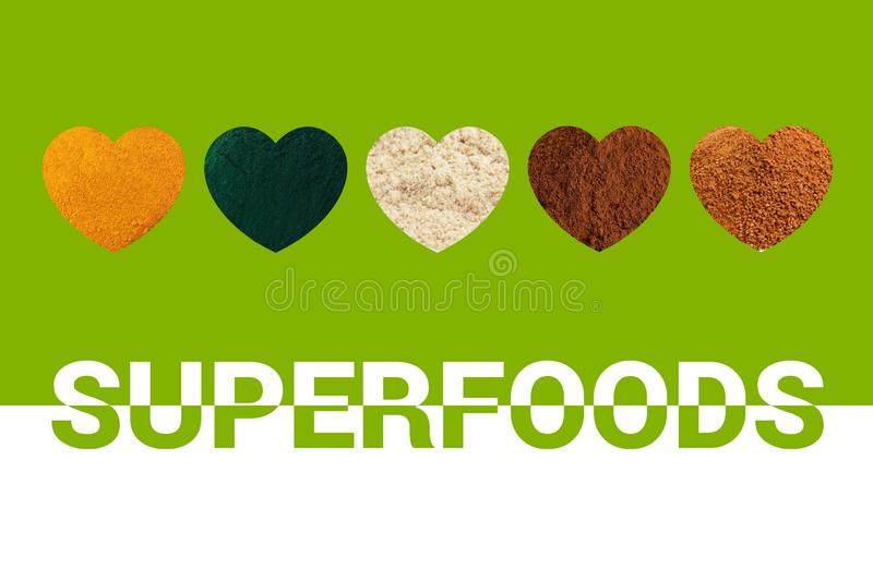 Hearts with turmeric, spirulina, cacao powders, almond flour and coconut palm sugar on green background. stock photos