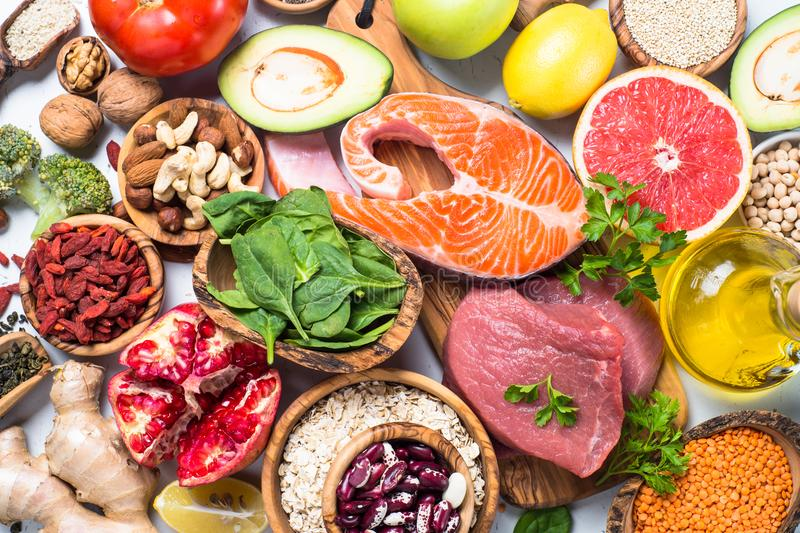 Superfoods on white background. Healthy nutrition. Superfoods on white background. Organic food for healthy nutrition. Meat, fish, legumes, nuts, seeds, greens stock images