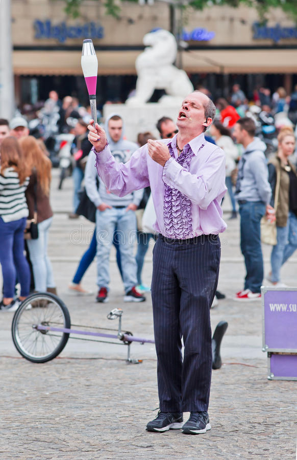 Superfrank the street performer at Dam Square, Amsterdam, Netherlands. AMSTERDAM-AUGUST 26, 2014. Superfrank the street performer. Amsterdam offers every summer royalty free stock image