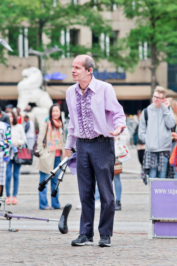Superfrank the street performer at Dam Square, Amsterdam, Netherlands. AMSTERDAM-AUGUST 26, 2014. Superfrank the street performer. Amsterdam offers every summer royalty free stock photos