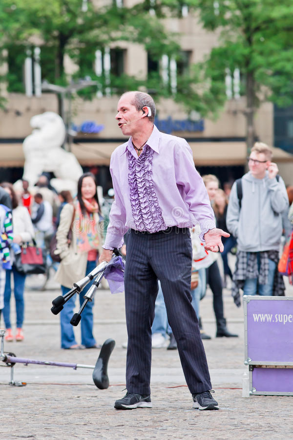 Superfrank the street performer at Dam Square, Amsterdam, Netherlands. AMSTERDAM-AUGUST 26, 2014. Superfrank the street performer. Amsterdam offers every summer stock photos