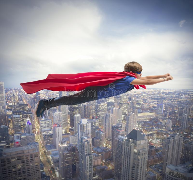 Superheldkind. lizenzfreie stockbilder