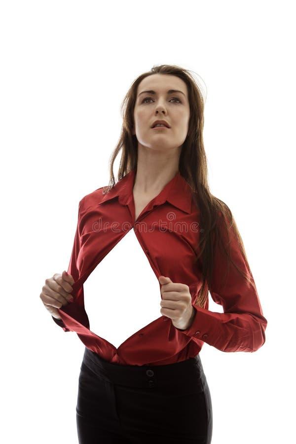 Superhero. Attractive businesswoman pulling her shirt apart doing a superhero business poses stock photo