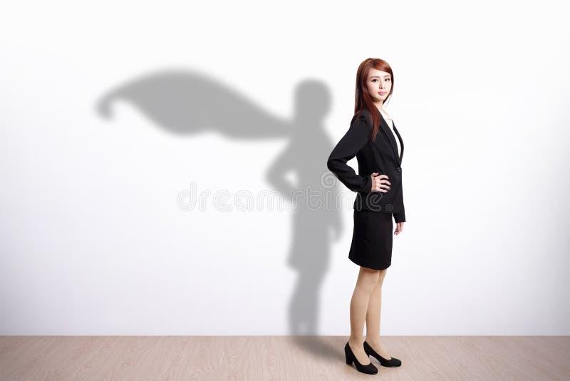 Superhero Bedrijfsvrouw stock foto's
