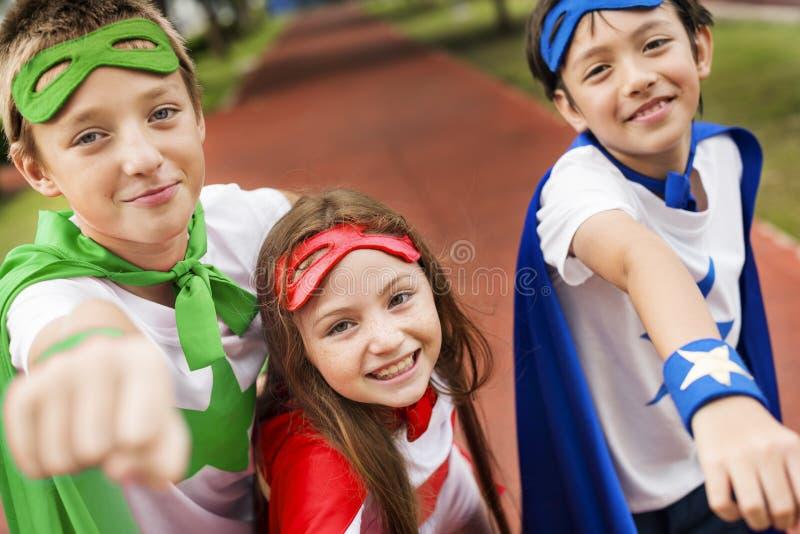 Superhero Boy Girl Brave Imagination Concept royalty free stock photography