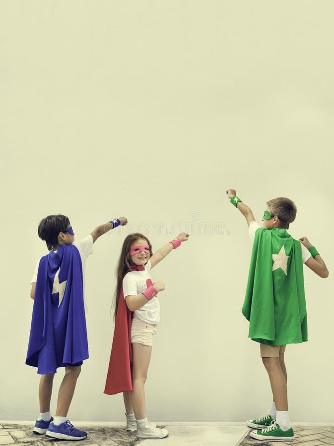 Superhero Boy Girl Brave Imagination Concept stock photo