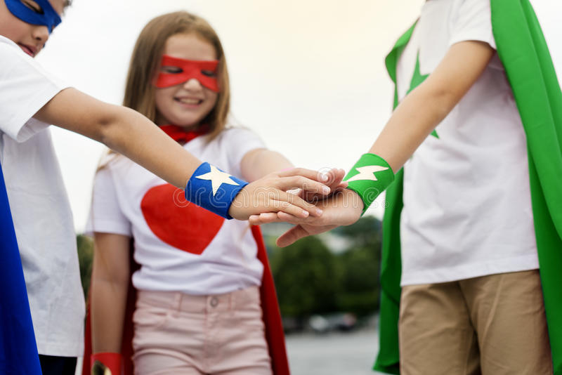 Superhero Boy Girl Brave Imagination Teamwork Concept stock photography