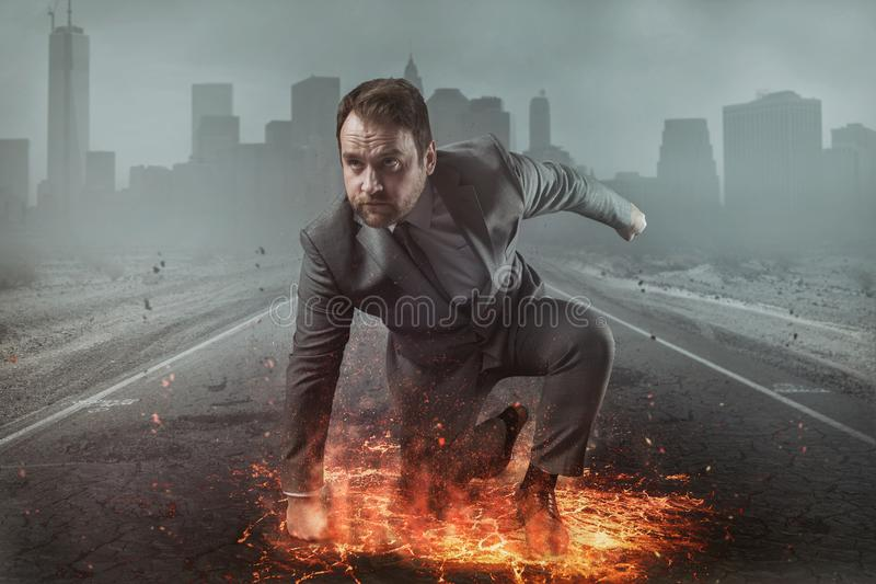 Superhero businessman concept with fire and city background royalty free stock photography