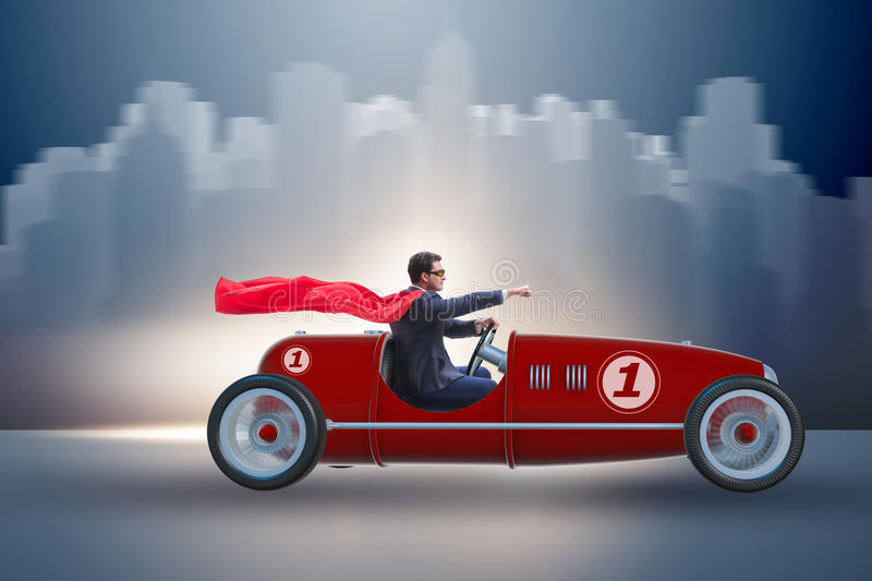 The superhero businessman driving vintage roadster royalty free stock image
