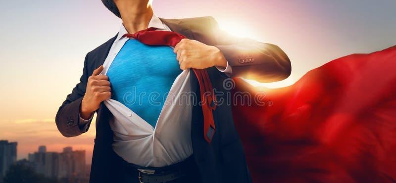 Superhero businessman looking at city royalty free stock images