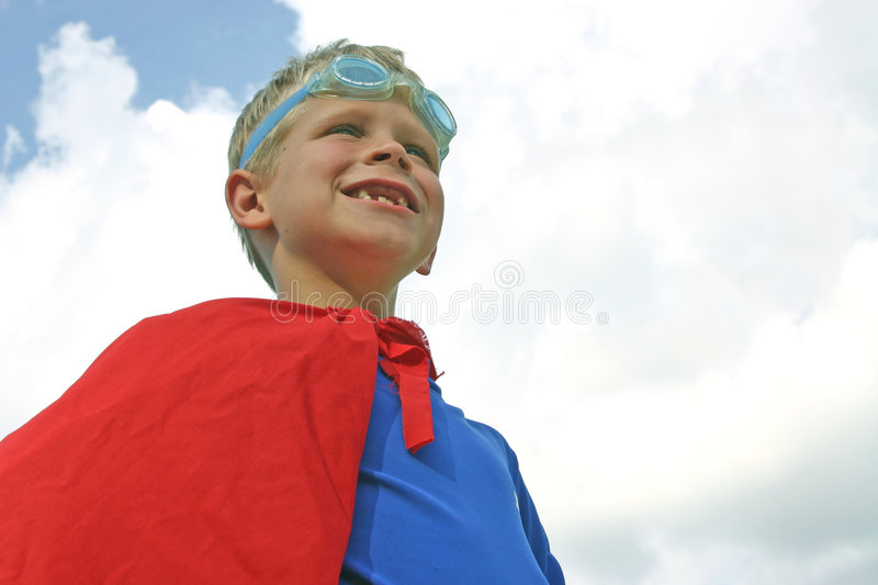 Superhero in Clouds royalty free stock image
