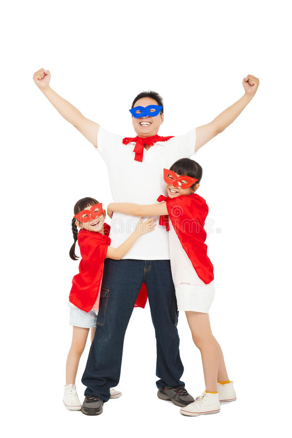 Superhero daughters hug father waist. isolated on white royalty free stock photography