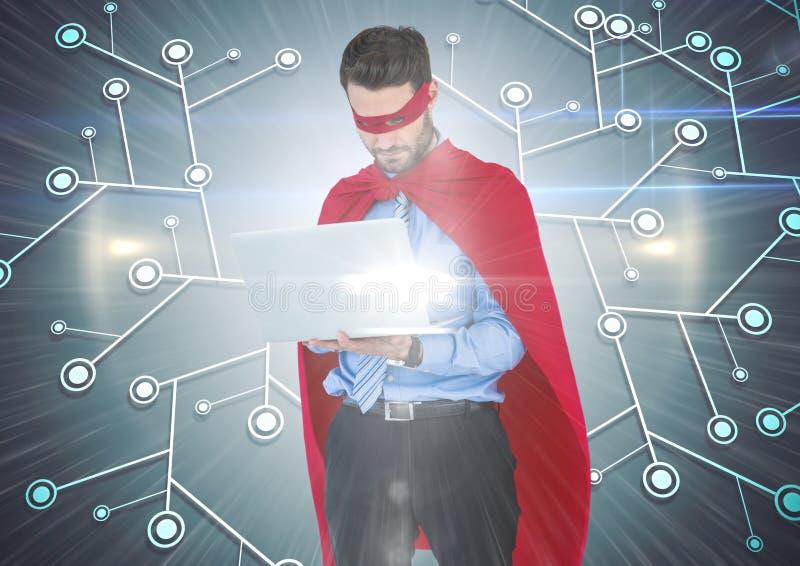 Superhero för affärsman med bärbara datorn mot nätverk med signalljuset arkivfoton