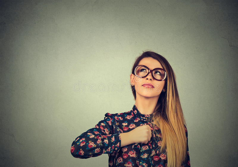 Superhero girl. Confident woman in glasses. Human emotions face expression royalty free stock image