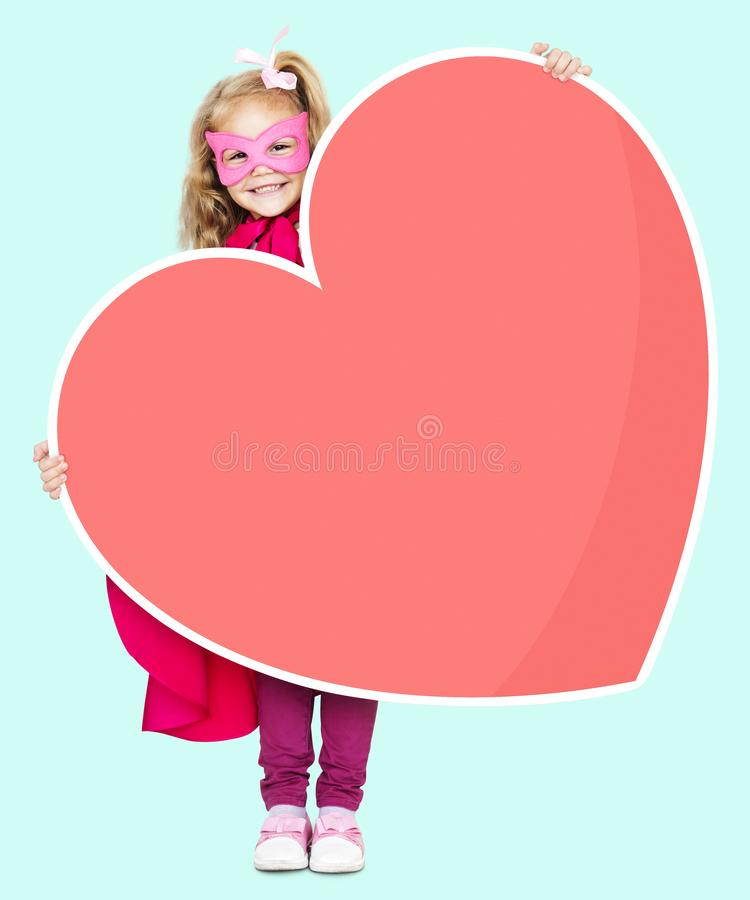 Superhero girl holding a heart icon stock images