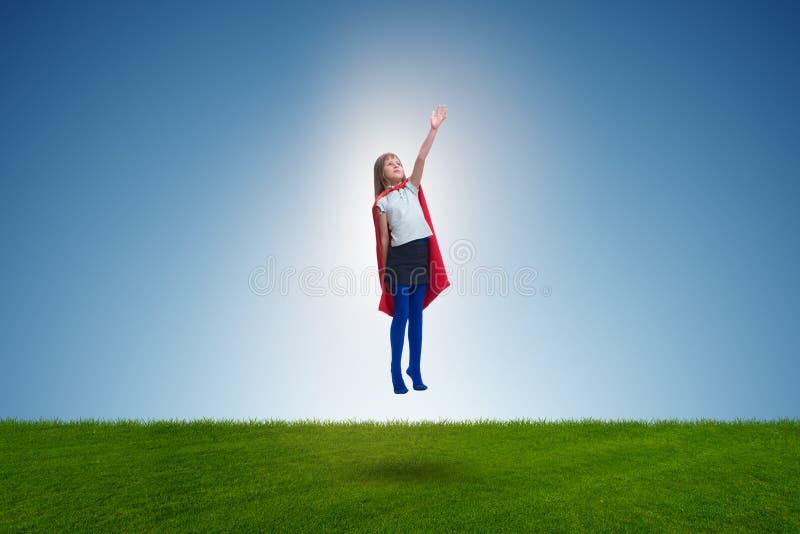 The superhero kid flying in dream concept. Superhero kid flying in dream concept stock images