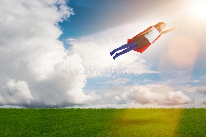 The superhero kid flying in dream concept. Superhero kid flying in dream concept royalty free stock images