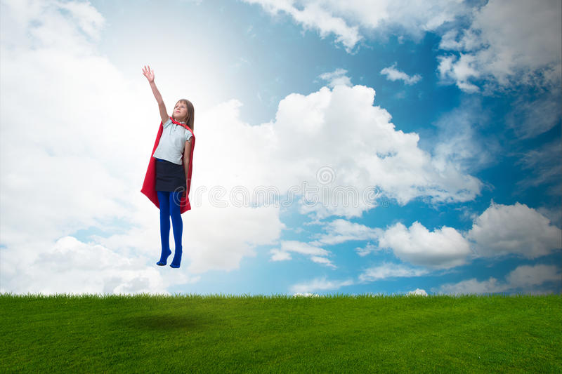 The superhero kid flying in dream concept. Superhero kid flying in dream concept royalty free stock photo