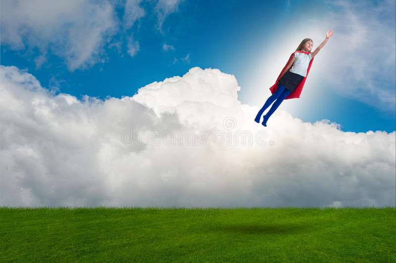 The superhero kid flying in dream concept. Superhero kid flying in dream concept royalty free stock photography