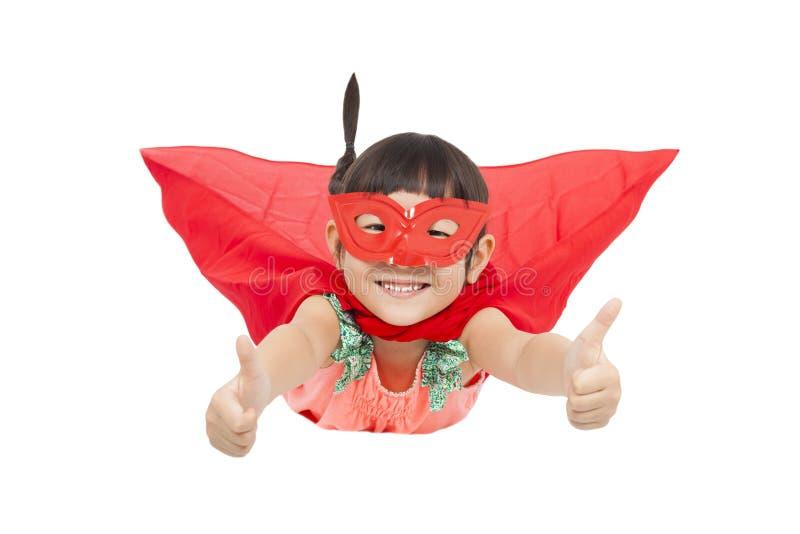Superhero kid flying and thumb up. isolated on white stock photo