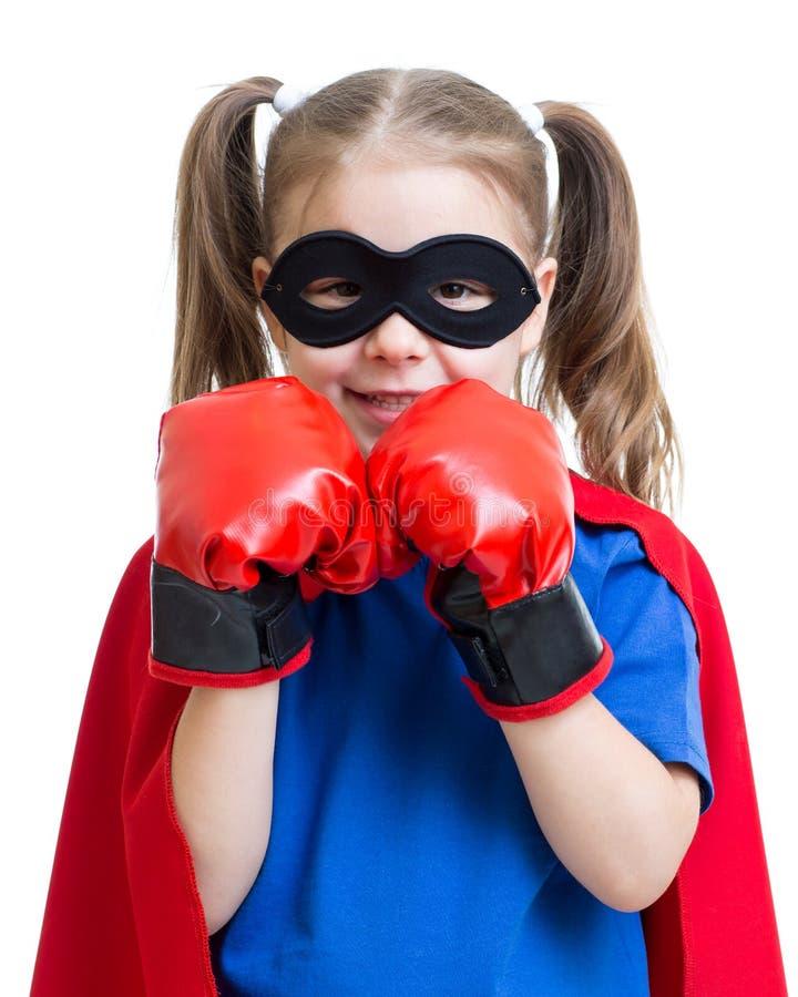 Superhero kid wearing boxing gloves royalty free stock images