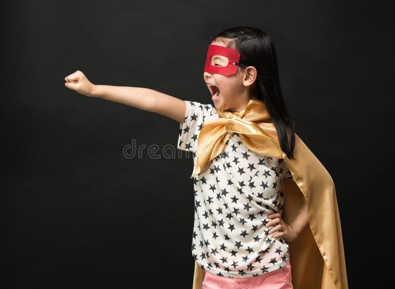 Superhero kids on a black background. Fly Super Hero royalty free stock image